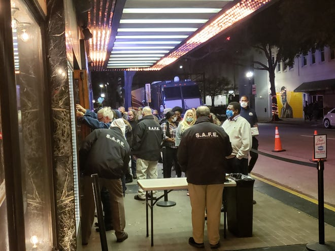Fans entering a Wailers concert at the Florida Theatre on Feb. 20 go through standard security checks, but also have their temperatures taken. Masks are required in line and inside the venue.