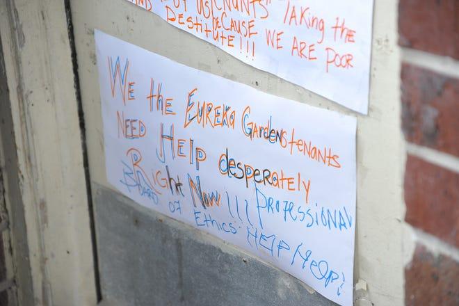 A sign on the door of  a Eureka Garden, circa 2015, apartment begs for help.