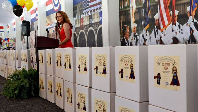 LeAnn Morrisey, found of Operation Shower, shows off gift packages for military mothers-to-be during the 2016 event. This year's Operation Shower on Feb. 28 will be a drive-in experience at the TPC Sawgrass.