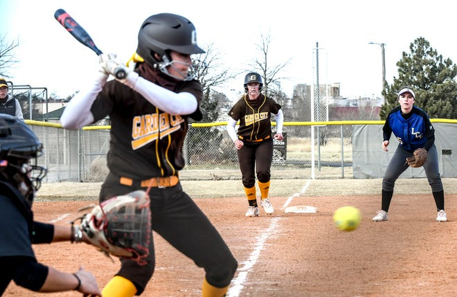 Garden City Community College's Carly powley, center, leads off third base as teammate Arianna Griego bats Thursday against Lamar, Colo., during a doubleheader at Tangeman Spors Complex.