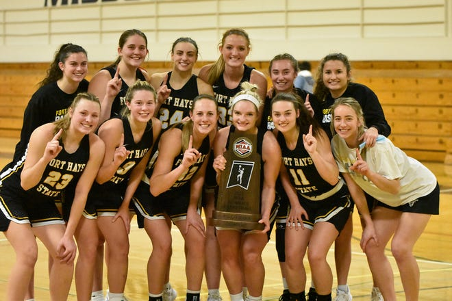 The Fort Hays State women's basketball team gather for a photo after clinching at least a share of the MIAA championship with a win at Missouri Western on Thursday.