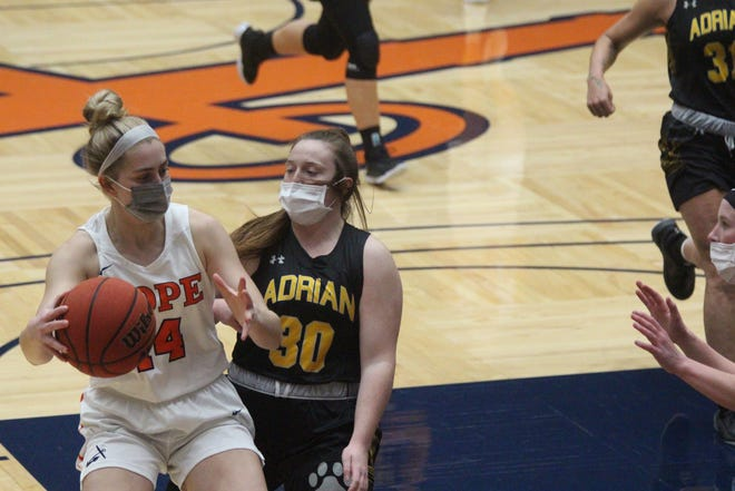 Junior Kate Majerus drives to the hoop during Hope's win over Adrian on Thursday, Feb 25, 2021