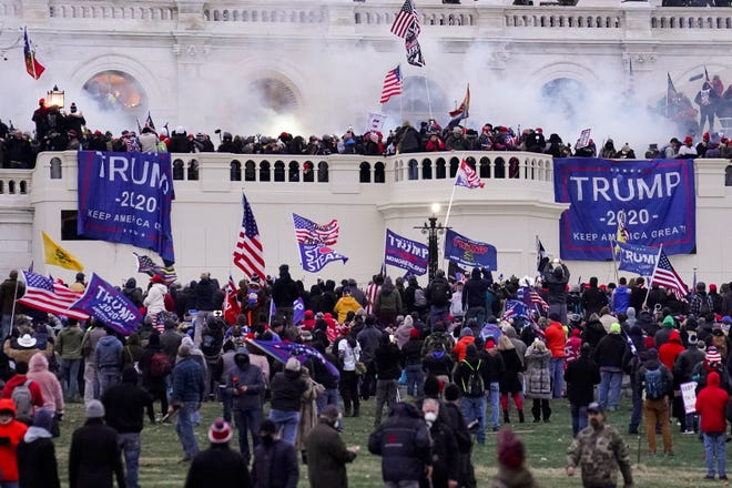 In this Jan. 6, 2021, file photo, violent rioters supporting President Donald Trump storm the Capitol in Washington, D.C.