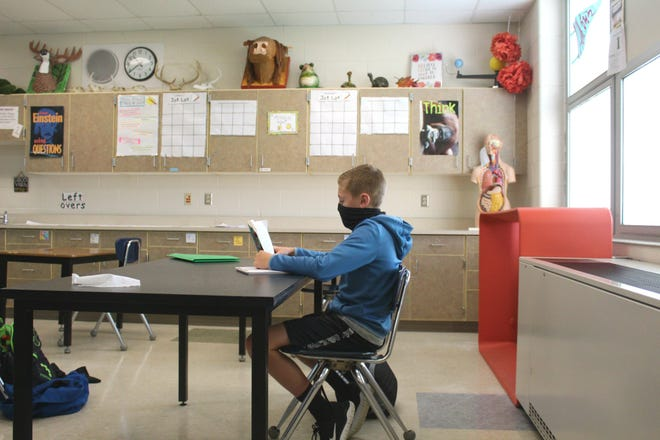 A student from Hamilton Community Schools reads during class time earlier this school year.