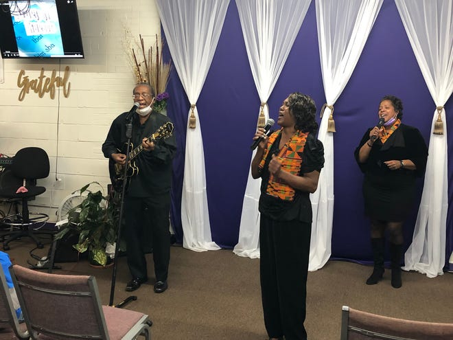 """From left to right, James Jackson, Linda Smith and Compton Tucker perform the song """"Oh Freedom!"""" at the Rise Up! 2021 event on Thursday."""