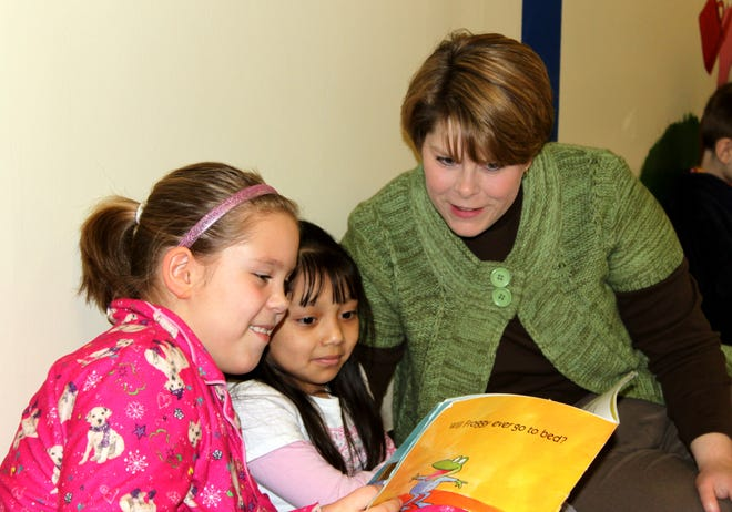 Jan King reads with former students who have now graduated high school.