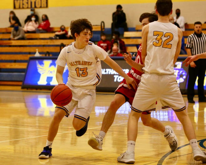 Garrett Robertson heads for the basket during the Salthawks matchup against Maize. On senior night, Hutch fell to the Eagles 57-39.