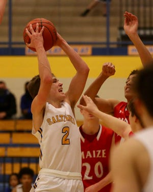 Jake Huhs shoots for the basket during the Salthawks matchup against Maize. On senior night, Hutch fell to the Eagles 57-39.
