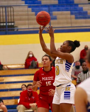 Ziya Simms shoots for the basket during the Salthawks matchup against Maize. On senior night, Hutch fell to the Eagles 46-29.