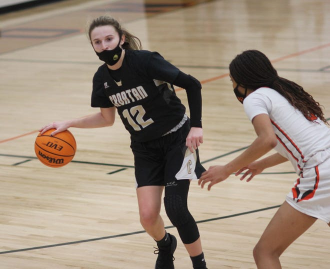 Croatan's Haley Cousins brings the ball up the court during the Cougars' 48-36 win at Southwest on Thursday night in the second round of the NCHSAA 2-A girls' basketball playoffs. [Chris Miller / The Daily News]