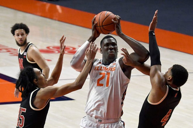 Illinois center Kofi Cockburn (21) shoots as he is pressured by Nebraska's guards Dalano Banton and Shamiel Stevenson (4) in the second half of an NCAA college basketball game Thursday, Feb. 25, 2021, in Champaign, Ill. (AP Photo/Holly Hart)