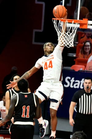Illinois guard Adam Miller (44) lays the ball in as Nebraska forward Lat Mayen (11) defends during the second half of an NCAA college basketball game Thursday, Feb. 25, 2021, in Champaign, Ill. (AP Photo/Holly Hart)
