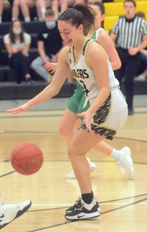 Newton foreign exchange student Cecelia Merlini takes a pass during play Thursday. Newton plays Tuesday at Emporia to open Class 5A sub-state.