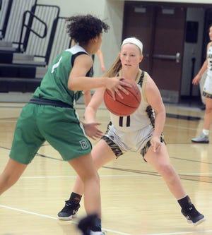 Newton sophomore Piper Seidl guards Derby freshman Destiny Smith during play Thursday.