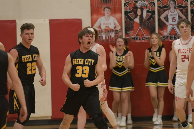 Green City's Tristian Herschberger reacts after sinking a basket while getting fouled during Thursday's district title game against Novinger.