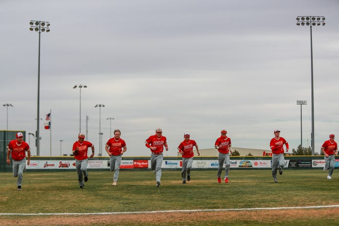 Coronado players warm up before the game against Caprock on Friday, Feb. 26, 2021, at First United Park in Woodrow, Texas.