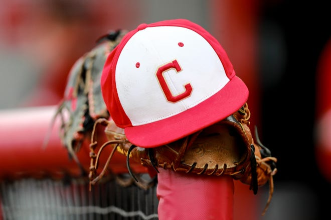 A Coronado hat sits on a glove in the Mustangs' dugout before the game against Caprock on Friday, Feb. 26, 2021, at First United Park in Woodrow, Texas.