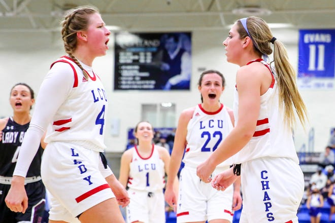 Lubbock Christian players, from left, Emma Middleton, Ashton Duncan, Juliana Robertson and Laynee Burr celebrate a basket for Burr during the Lady Chaps' 68-42 win over West Texas A&M on Thursday. The win was LCU's 88th in a row at home, breaking an NCAA Division II record.
