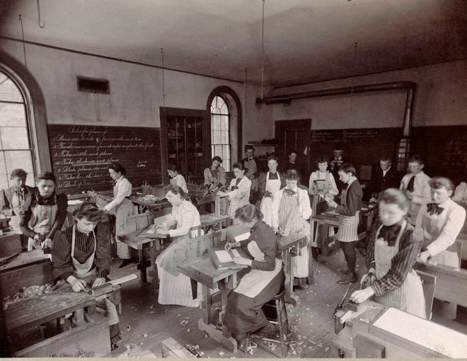 This classroom of girls is shown working at the Lyman School in East Boston in 1892.