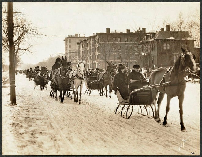 There was a lot of sled traffic on Beacon Street in February 1901. Learn more from Digital Commonwealth at www.digitalcommonwealth.org.