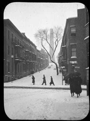 This is Monument Avenue as it was on a winter day in 1942. This is one of the younger Charlestown streets, having been opened in 1871 across certain fields and gardens and a vineyard of Evelina L. Harding's forebears, after the city fathers had decided not to build a straight approach to the monument directly from City Square. A double row of Norway Maples was set out on the avenue in the fall of 1942. Learn more from Digital Commonwealth at www.digitalcommonwealth.org.