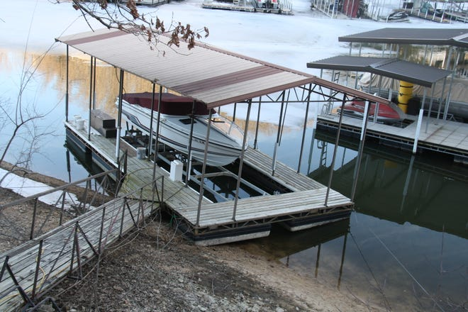 A local dock sits incorrectly positioned as surrounding water levels reach lows.