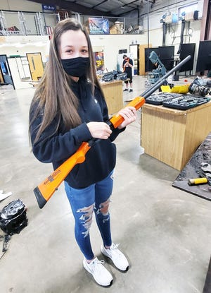 Hunter-education graduate Sophia Raines, an eighth-grade student in Hallsville, demonstrates her proficiency in safely handling a pump-action training shotgun.