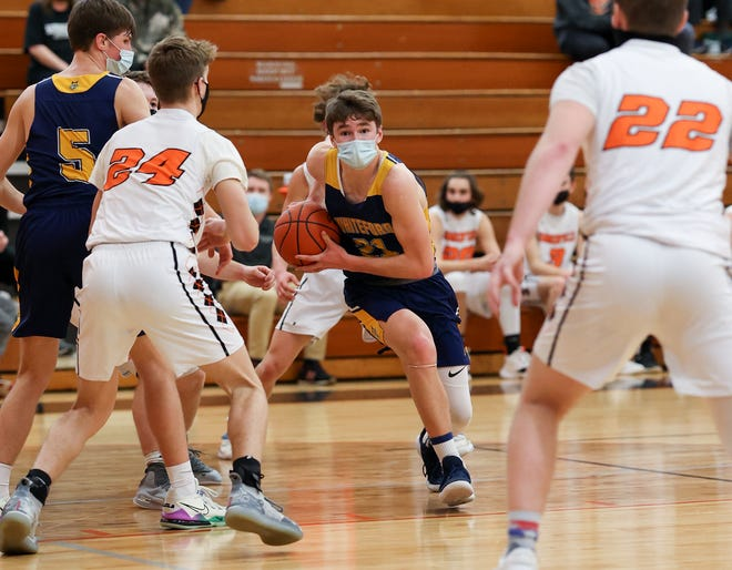 Cole Giesige of Whiteford looks for a path to the basket as Drew Dafoe (24) and Ethan Eyler of Summerfield defnd Thursday night. Summerfield won 47-27.