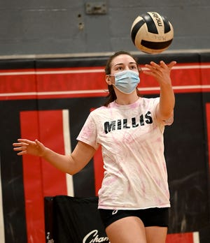 Millis volleyball player Mahoney Cyr serves during practice on Feb. 26, 2021.
