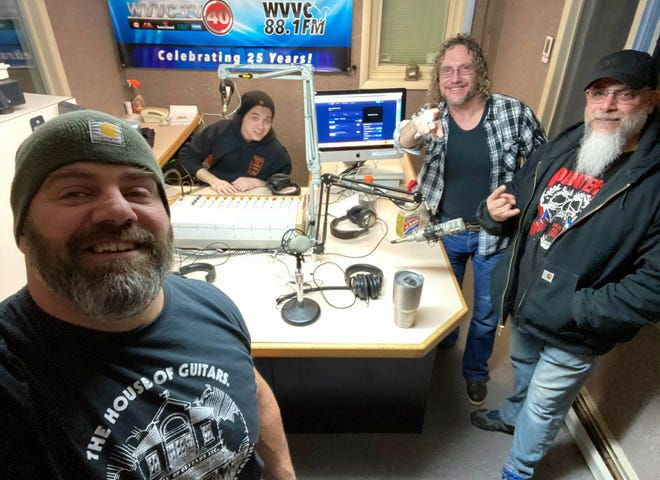 Chatting in the WVVC FM studios Feb. 13 in New Hartford are, from left, Vito Daniello, Dan 'Dax' Jackson, Rick 'Steck' Andrews and Eric Cesari. Andrews and Jackson are the co-hosts of the new Metal Sharpens Metal local music show Saturday nights at 8 p.m. and Daniello and Cesari are their special guests from the local duo EV.