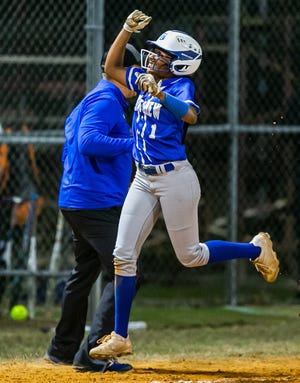 Belleview's Jaela Haynes celebrates while rounding third base after hitting a three-run blast home run to make it 8-0. The Belleview Rattlers defeated the Dunnellon Tigers, 8-3, Thursday night.