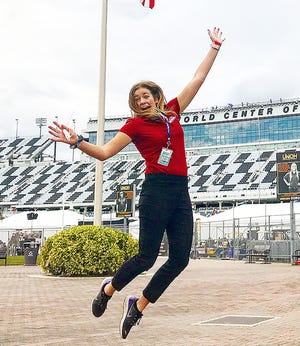 Hannah Conlisk of Chenoa jumps for joy at Daytona International Motor Speedway. Conlisk, a recent graduate of the University of Iowa, started as a NASCAR guest services intern at the Daytona International Speedway in January.