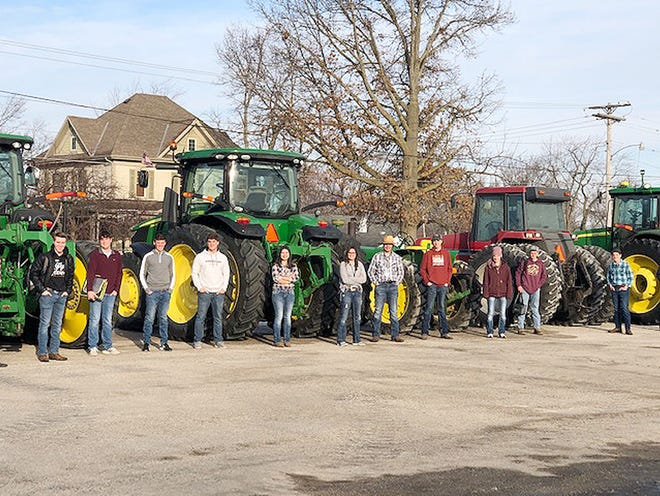 Students line up by tractors, a chosen mode of transportation to school this week at Prairie Central High School.