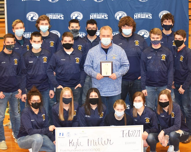 Kyle Miller stands with students after being named a finalist for the Golden Owl ag teacher of the year award.