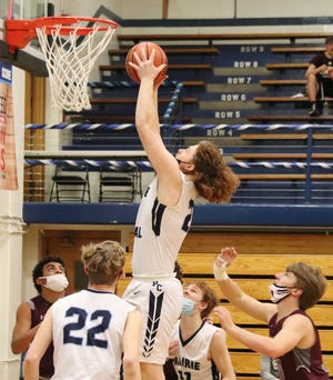 Cooper Palmore grabs a rebound for Prairie Central during its game with Tolono (Unity) Thursday. The Hawks won the Senior Night contest 64-48.