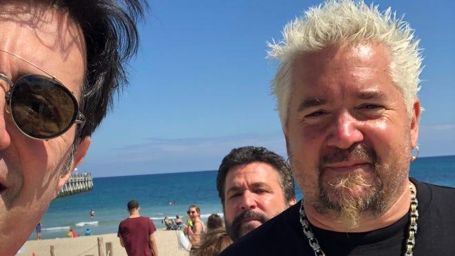 Richard J Guercio poses with Guy Fieri on Lake Worth Beach on Friday, Feb. 26.