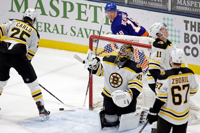Boston Bruins goaltender Jaroslav Halak (41) reacts after giving up a goal to New York Islanders left wing Anthony Beauvillier during the third period of an NHL hockey game, Thursday, Feb. 25, 2021, in Uniondale, N.Y. (AP Photo/Adam Hunger)