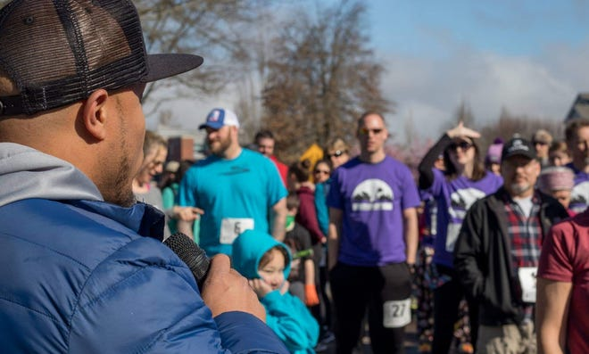 """Andre Royal emcees and directs """"Suddenly Sleepy 5K"""" runners."""