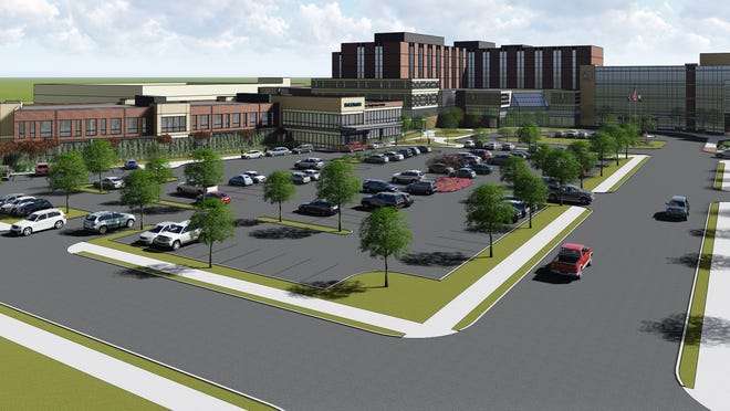 A rendering of the Timken Family Cancer Center as viewed from the corner of Sixth Street SW and Arlington Avenue SW with the existing hospital building on the right