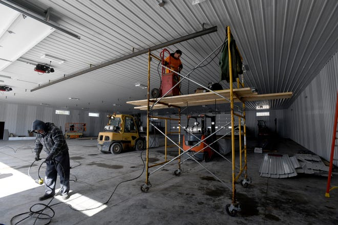Dutchcraft Truss & Metal in Paris Township is expanding with a new facility to meet demand for home trusses. The ongoing construction is shown here last week.