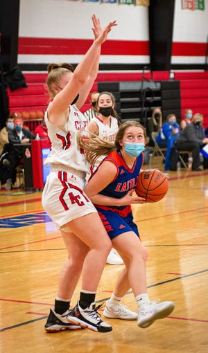 Talena Rogers, shown driving around Amboy's Olivia Dinges, was one of two unanimous first-team all-conference picks for Eastland, which tied state No. 1 Amboy for the NUIC South girls basketball title in 2021.
