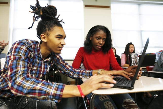 Rockford East High School student Chris Hodge, then 16, works with fellow student Catalya Johnson on Dec. 7, 2017, at the school.
