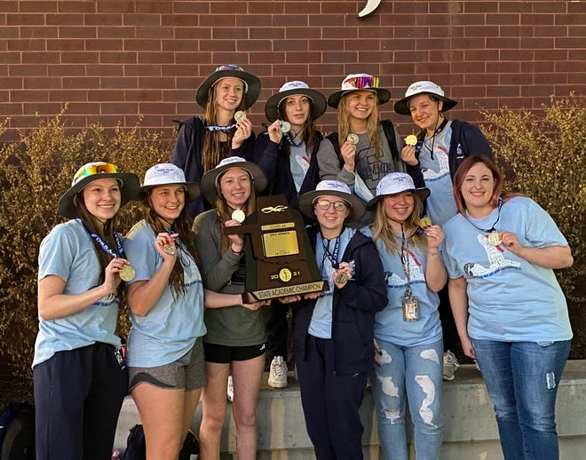 The Shawnee girls' swim team poses after being honored as state academic champions.