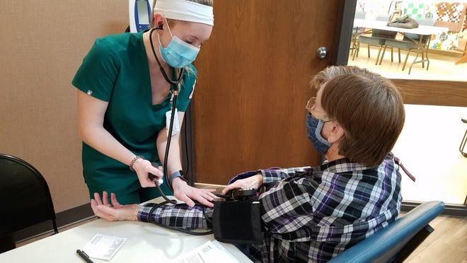 OBU nursing student Summer Moran checks blood pressure at Checks and Chats Friday.