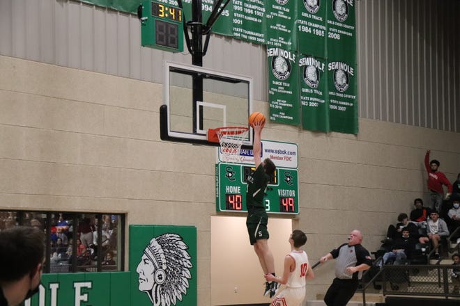 Bryce Marshall goes up for the two-handed slam Thursday night against the Ft. Gibson Tigers.