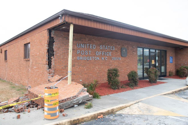 A decorative wall and the corner of hte Bridgeton Post Office was knocked down when a woman's foot went off the break of her vehicle Thursday afternoon.
