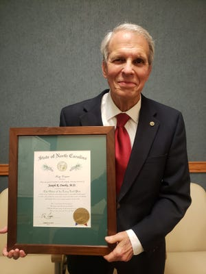 Retired physician, Dr. Joseph Overby of New Bern, was recently awarded the state's highest honor, the Order of the Long Leaf Pine Award for his many years of service to New Bern and the medical profession. [CONTRIBUTED PHOTO]