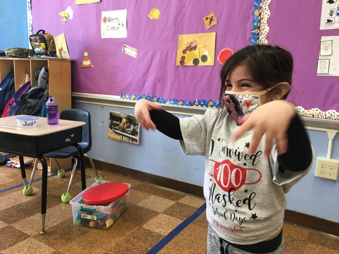 Judith Garcia, 3, plays inside her pre-kindergarten class at Danielson's St. James School on Friday as part of a celebration of the school's 100th day of in-person learning.