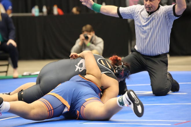 Salina Central's Rebekah Franklin works a pin of Olathe East's Akiya Tinsley in the 235-pound third-place match at Thursday's Girls Division I State Championships at Hartman Arena in Park City. Franklin finished third and was one of three placers for the Mustangs.