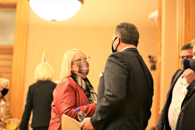 Sen. Molly Baumgardner, left, talks Thursday with Kansas Senate President Ty Masterson before a committee hearing. Both are playing a major role in shaping Kansas Emergency Management Act legislation.